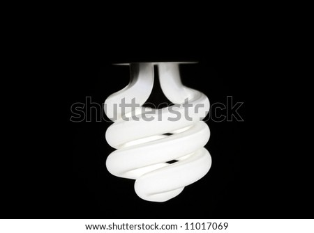 Glowing Compact Fluorescent Bulb - stock photo