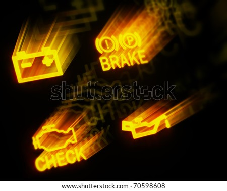 glowing dashboard signs on black background