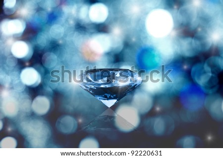 Glowing diamond on blurred background - stock photo