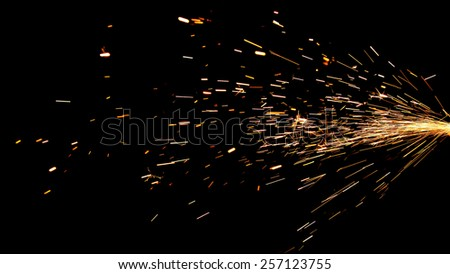 Glowing Flow of Sparks in the Dark - stock photo