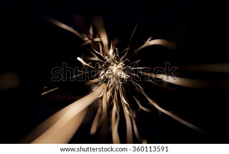 Glowing Flow of sparks in the Dark in motion. Sparkling stars dust trail (light effect) - stock photo