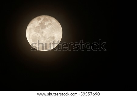 Glowing full moon with plenty of space for text - stock photo