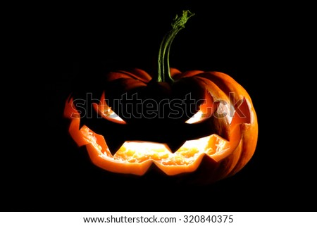 Glowing Halloween jack o' lantern - stock photo