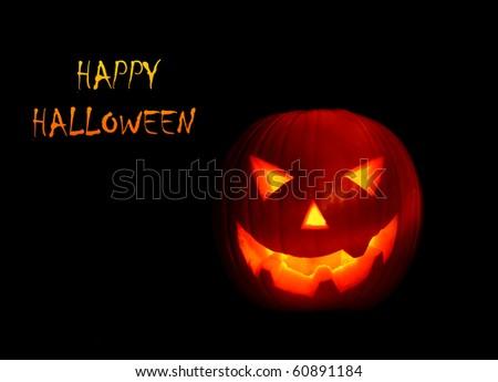 Glowing Halloween pumpkin isolated on black - stock photo