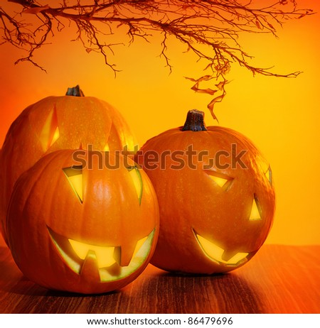 Glowing Halloween pumpkin, warm candle light, autumn holiday background, traditional jack-o-lantern, night party decoration - stock photo