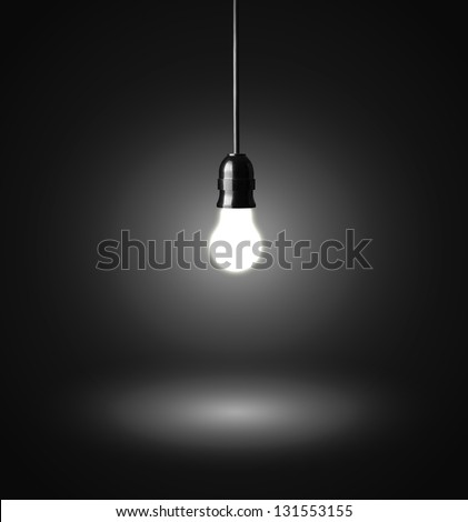 glowing hanging light bulb on a wire - stock photo