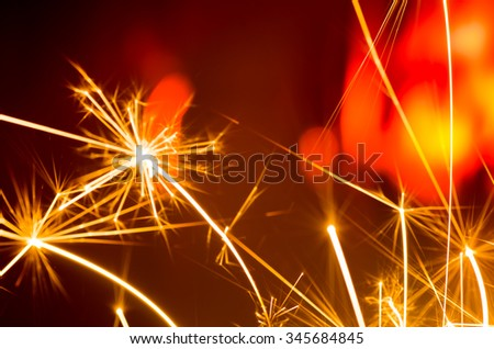 glowing holiday sparkler motion blur - stock photo