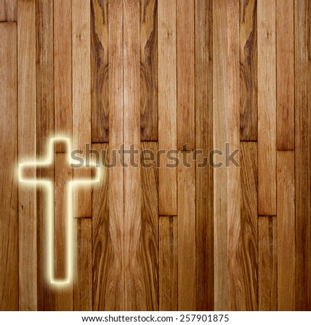 Glowing holy cross on abstract wooden background - stock photo