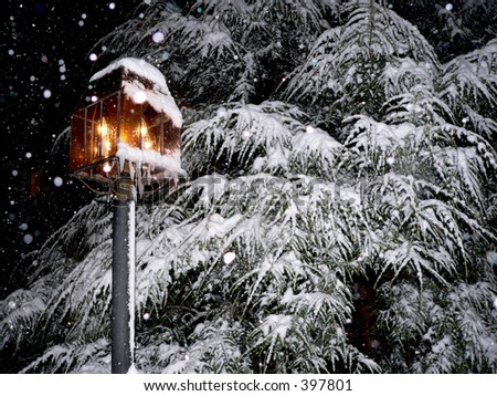 Glowing Lantern in Snow During Christmas - stock photo
