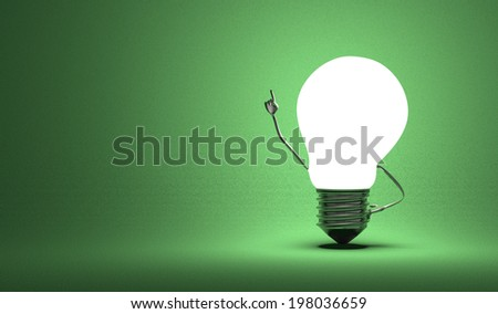 Glowing light bulb character in moment of insight on dark green textured background - stock photo