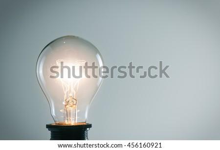 Glowing light bulb. Idea concept - stock photo