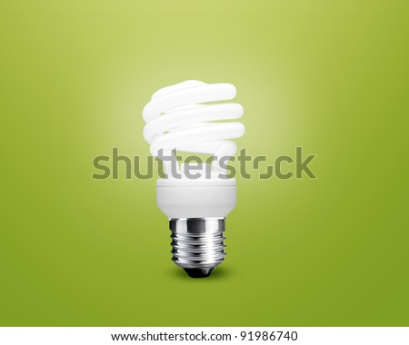 glowing Light bulb idea on green background - stock photo
