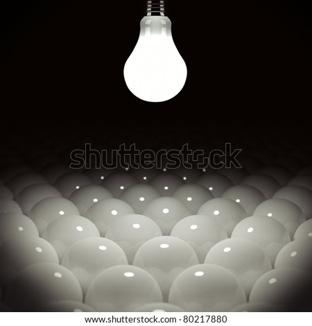 Glowing light bulb illuminating many light bulbs - stock photo