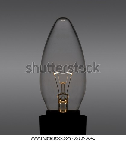 glowing light bulb in dark back - stock photo