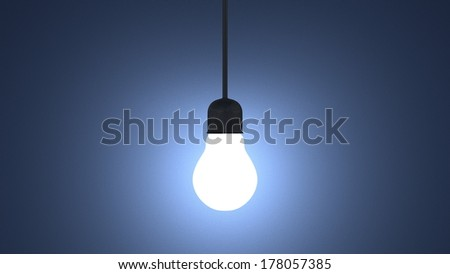 Glowing light bulb in lamp socket hanging on wire on dark blue textured background