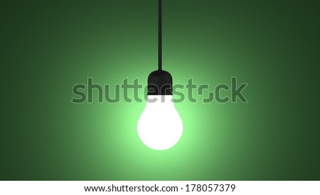 Glowing light bulb in lamp socket hanging on wire on dark green textured background