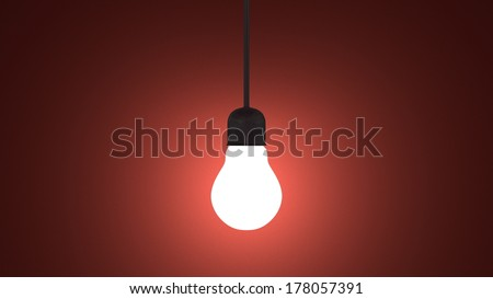 Glowing light bulb in lamp socket hanging on wire on dark red textured background - stock photo