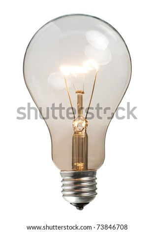 Glowing light bulb on white background - stock photo