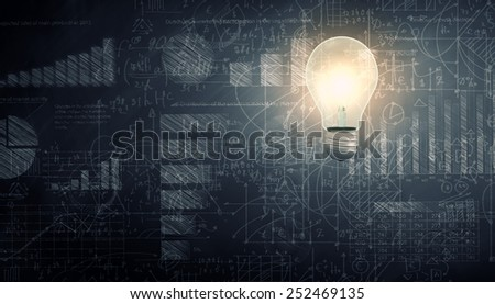 Glowing light bulb with sketches at background - stock photo
