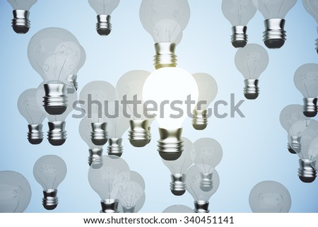 Glowing lightbulb among others with blue background 3D Render - stock photo