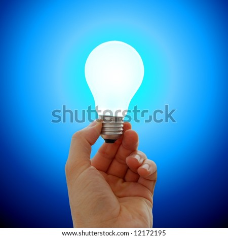 Glowing lightbulb in a hand - stock photo