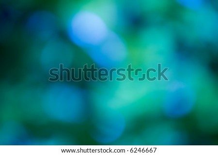 Glowing lights as abstract green and blue blurry background. - stock photo