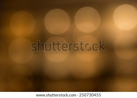 Glowing Lights Behind Brown Transparent Glass in Attractive Diffuse Effect, Emphasizing Copy Space - stock photo