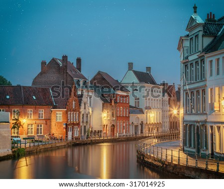 glowing lights in dusk of medieval Bruges old town, Belgium - stock photo