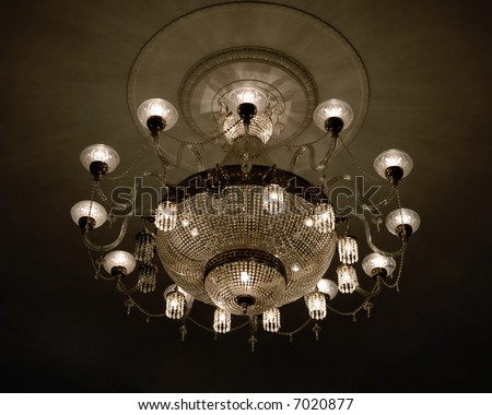 Glowing lustre at the assembly hall - stock photo