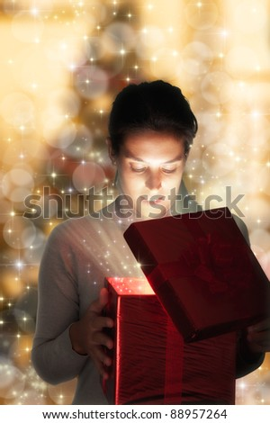 Glowing magic girl with Christmas present