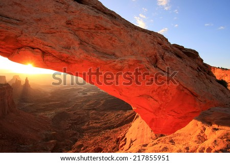 Glowing Mesa Arch at sunrise, Canyonlands National Park, Utah - stock photo