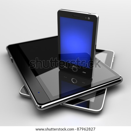 Glowing mobile phone standing on digital pads  - stock photo