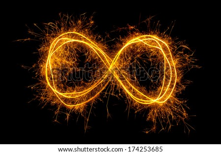 Glowing moebius strip infinity symbol isolated on black background - stock photo