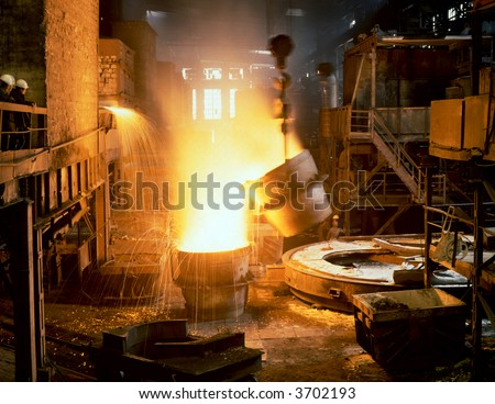 Glowing, molten hot steel. Steel casting. - stock photo