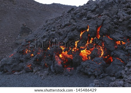 Glowing molten volcanic rock of Eyjafjallajokull Fimmvorduhals Iceland - stock photo