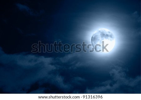Glowing Moon Close-up on Dark Blue Sky - stock photo