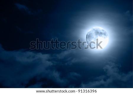 Glowing Moon Close-up on Dark Blue Sky - stock photo