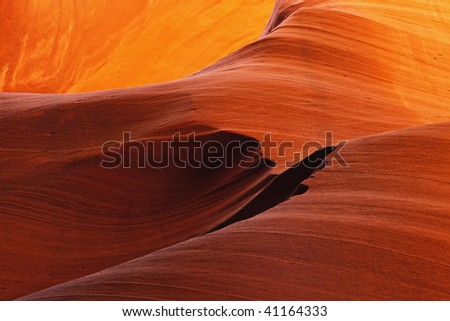 Glowing Navajo Sandstone inside a Slot Canyon in Page Arizona - stock photo