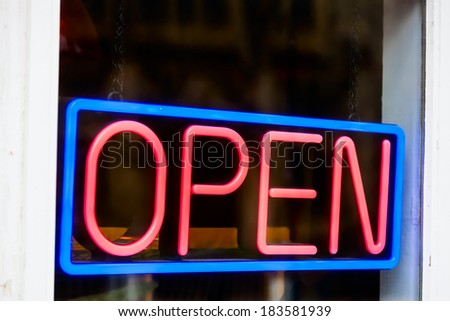 Glowing open neon sign in a window - stock photo