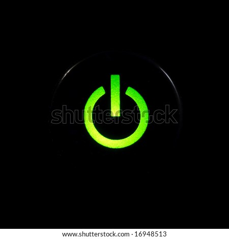 Glowing power button on black background - stock photo