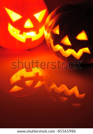 Glowing pumpkin with a candle inside. Decorations for Halloween. - stock photo