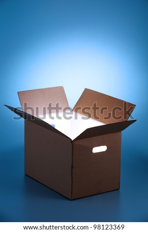Glowing rays of light coming out of an open box - stock photo
