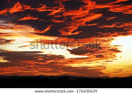 glowing red clouds at sunset