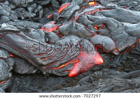 Glowing red hot lava. - stock photo