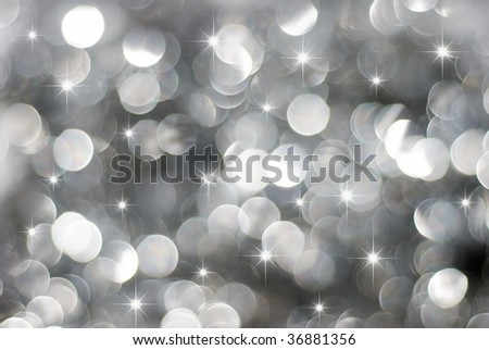 Glowing silver Christmas lights background with little stars - stock photo