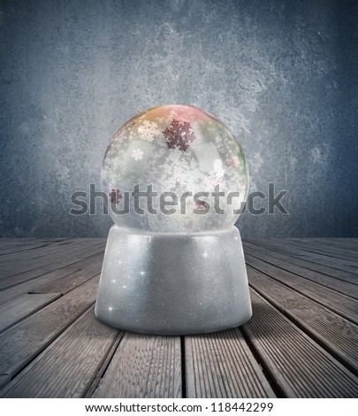 Glowing snow sphere in a vintage room - stock photo