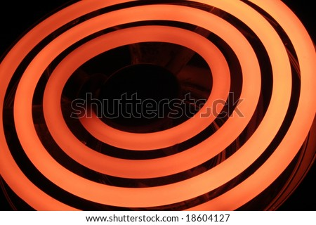 Glowing stove coil (long exposure) - stock photo