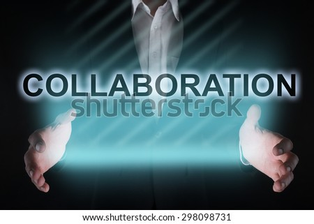 "Glowing text ""Collaboration"" in the hands of a businessman. Business concept. Internet concept. - stock photo"