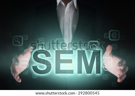 """Glowing text """"SEM"""" in the hands of a businessman. Business concept. Internet concept.  - stock photo"""