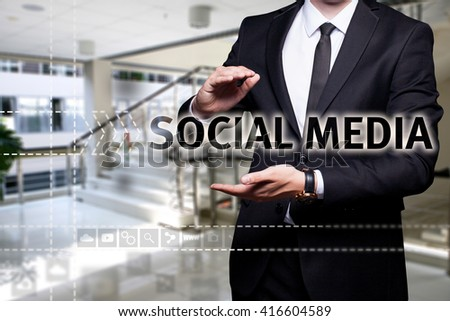 "Glowing text ""Social Media"" in the hands of a businessman. Business concept. Internet concept. - stock photo"